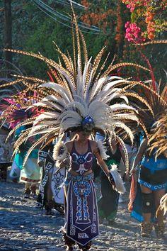 'Procession of Virgin Mary' in the 'Day of the Dead Parade', Ajijic, Jalisco, Mexico. 'Aztec Dancers' dance in honor of the Virgin Mary. Aztec Costume, Mexican Costume, Aztec Ruins, Aztec Dress, Mexican Heritage, Aztec Warrior, Inka, Aztec Art, Ecuador