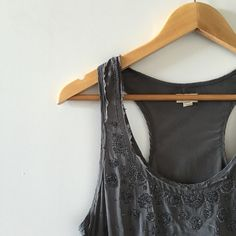 UO  100% Silk Beaded Racerback Tank Top Silence + Noise (Urban Outfitters Brand) 100% Silk Beaded Racerback Tank in Dark Grey. Beautiful, flowy racerback tank top. Beautiful Detail. Great for festival season as well as summer. All beads intact. Great Condition!!     ⇸ m y  c l o s e t ⇷ ✓ i accept all reasonable offers  ✓ make me an offer ♥ × no trade × no paypal Urban Outfitters Tops Tank Tops