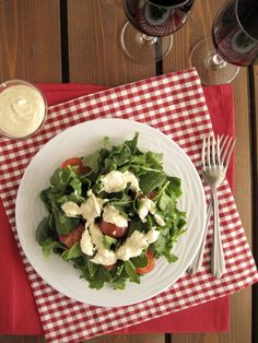 Arugula and cherry tomato salad with Parmesan dressing