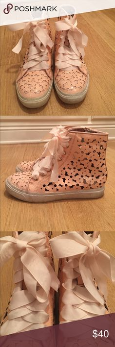 Jeffrey Campbell High Tops Pink leather laser cut high tops by Jeffrey Campbell with pale pink grosgrain ribbon laces. Zipper up sides. Size 7 (they run a little big as I am usually a 7.5). Jeffrey Campbell Shoes Sneakers