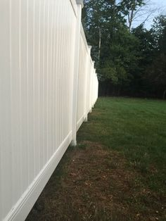 Beautiful vinyl fence protected by Fence Armor.   We are proud to say that Fence Armor offers a simple and beautiful installation option that has filleted corners to make sure it doesn't harm your furry companions or the trimmers.  #fencearmor #fenceinstallation #fenceprotector #postprotector #vinylfence #smallbusiness #backyard #backyardoasis #fencebuilding #vinyl #diy #doityourself #rotprevention #preventrot  #vinylprotection #postrot #preventpostrot #postsaver Building A Fence, Curb Appeal, Backyard, Simple, Outdoor Decor, Diy, Beautiful, Home Decor, Homemade Home Decor