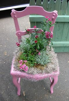 Best repurposed outdoor chair I have seen yet! Would like the chair better left in it's natural colour or painted green and in the garden amoung other plants but still like the idea.