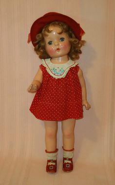 """""""Sally Joy"""" made by American Character in the 1930's; marked Petite. She is 18 inches tall, with a composition swivel head on shoulder plate and composition limbs on a cloth body. She has her original mohair wig and brass barrettes, sleep tin eyes with full lashes and great coloring. She wears her original, red dotted dress with matching onesie, a great wool felt hat as well as original shoes and socks.Z"""