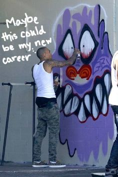 Chris Brown was spotted doing some new and approved graffiti on the outside wall of a tattoo parlor!