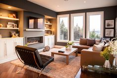 Linear fireplace with leather couch