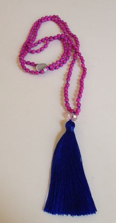 Wooden pink beads with blue tassel necklace on Etsy, $20.00 AUD