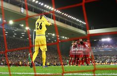 Steven Gerrard of Liverpool celebrates scoring the second goal from the penalty spot with team...