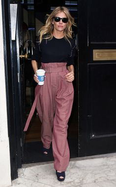 Fun pants! The Live by Night actress is seen rocking a pair of blush colored pants in London.