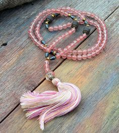 Mala necklace made of 108, 8 mm - 0.315 inch, very beautiful smooth and faceted cherry quartz gemstones and decorated with frosted smokey quartz and hematite - look4treasures on Etsy