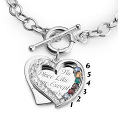 A mom's love is the heart of her family. Celebrate it, and her, with this gorgeous birthstone bracelet. Our unique take on the classic pendant, it features two hearts - one a solid, sterling silver plaque ready to engrave with a special note or quote, the other an open heart with glimmering CZ stones. It can accommodate up to six birthstones, one to represent each member of her family. A truly meaningful gift, and one she can love for a lifetime.<br><br>-Also available in a m...