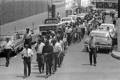A civil rights march in downtown Hattiesburg. Courtesy Mississippi Department of Archives and History, PI/1994.0005/Box 161, Folder 1.