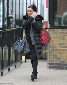 Cosy: Christine Bleakley made sure to wrap up warm in her large chunky coat and skinny jeans as she left the ITV studios in central London on Thursday