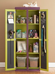 Pet Station An armoire outfitted with shelves tames pet supplies, while the chalkboard inside the doors displays reminders for playdates and appointments. Spacious, divided compartments provide a manageable way to organize treats, toys, and grooming supplies; each one is tall enough to organize bins and boxes of all sizes.