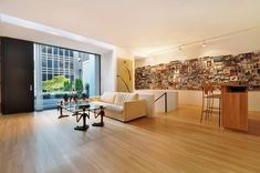 Gunter Sachs' modern carriage house in Manhattan's Upper East Side.  Click through for all the pics, but I love the wall of photos