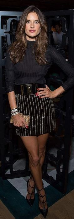 Alessandra Ambrosio: Bracelet – Cartier  Skirt and belt – Balmain  Shoes – Christian Loboutin  Purse – Judith Leiber