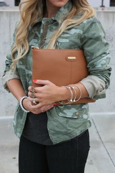 Camo jacket with gold accessories