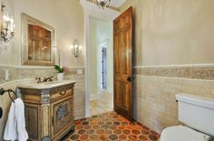 Traditional Powder Room with Merola Tile Nature Beige 15-1/4 in. x 16 in. Ceramic Floor and Wall Tile, penny tile floors