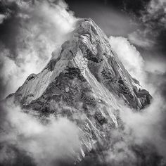 """Photo @coryrichards Where do you go when you dream? Ama Dablam rises from a storm in the Khumbu Valley, #Everest region, Nepal. @thephotosociety @natgeocreative @thenorthface..."
