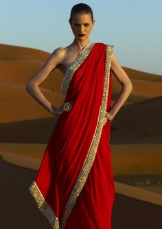 Red saree with gold sequi border by Abu Jani and Sandeep Khosla