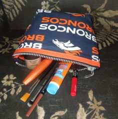 Denver Broncos Make up bag / Clutch Purse https://www.etsy.com/listing/231936953/denver-broncos-make-up-bag-clutch-purse
