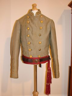 Confederate Officer's Double Breasted Shell Jacket. Worn by First Lt. Edward Bryan, 31st North Carolina Infantry Regt. wounded at Cold Harbor and surrendered May 1865. Two bars on each side of collar together with one gold bullion quatrefoil on each sleeve reflect rank. ( One row Quatrefoil - 1st and 2nd Lt. ; Two rows - Capt.; Three rows - Major, Lt. Col., Colonel : Four rows - General )