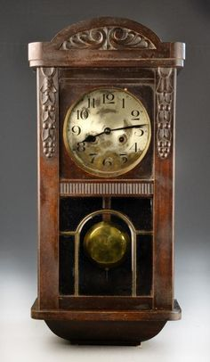 antique german pendulum wall clock carved arching conice and walnut case with beveled and leaded - Pendulum Wall Clock