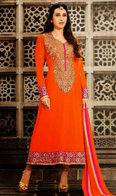Portray a look of muse of solemn beauty like Bollywood diva Karisma Kapoor does by stepping into this orange and beige embroidered georgette churidar suit. The lovely lace work all through dress is awe-inspiring. #BollywoodKarismaKapoorAnarkaliSuit