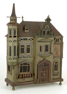 Folk Art Doll House- England, ca. 1880, whimsical folk house in Tudor style with fretwork. Unusual combination of Moorish and Continental architectural details in the tower and roof, and an exceptional removable front door with elaborately carved simulated hinges and grillwork.