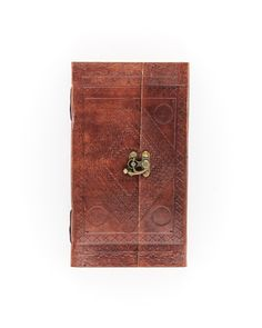 Voyager Journal-This leather journal features an intricate cover design, blank pages, and a beautiful latch closure.