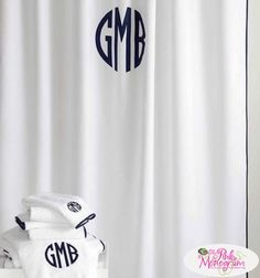 monogrammed chiaro shower curtain from matouk is a simple base with a sateen piping detail that
