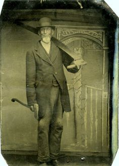 ca. 1860-90, [tintype portrait of a lumberjack gentleman armed with a saw, hatchet, and mischievous, albeit subtle, grin] via Jeffrey Kraus, Fine Photographics
