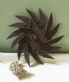 Vintage Farm Star Tine Wheel Sculptures Industrial Decor Rusty Metal Sculpture supply. $16.00, via Etsy.