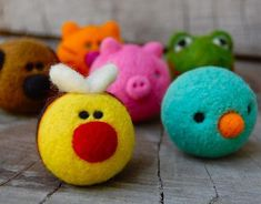 Needle felted cuddly creatures.  Makes me want to get out my needle and wool to make my own.