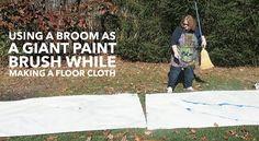 How to use a broom as a giant paint brush while making a floor cloth