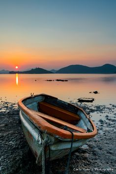 Boat resting, by Carlo Yuen... sky lake sea boat reflection river catamaran beach travel sun clouds coast pier shore seascape seashore boating jetty motorboat lakeside discover rowboat landingstage woodenboat