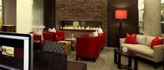 What's a lobby when you can have a fireside lounge? The Fitzgerald by Bozzuto.