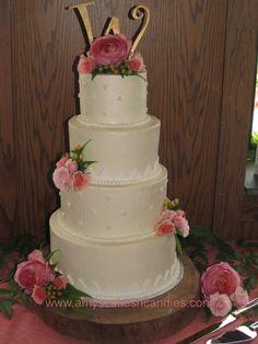 White & Ivory Buttercream Wedding cake with fondant accents & fresh Flowers