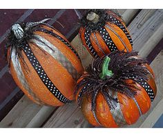 Ribbons are great accessories. With so many colors and patterns to choose from, it's easy to create stylish pumpkins sure to be the envy of the neighborhood. For glamorous details, add colored fringe to the top and consider painting the stem a matching color.   Materials: hot-glue gun, glue sticks, ribbon, fringe