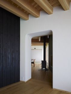 Charred wood Shou sugi ban wall, Exposed wood beams and ceiling, wood stove, Yatsugatake Villa in Hokuto-Cotu, Japan by MDS Architects, Photo by Toshiyuki Yano | Remodelista
