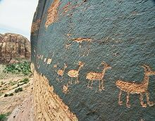 Petroglyph - A petroglyph of a caravan of bighorn sheep near Moab, Utah, United States; a common theme in glyphs from the desert southwest.