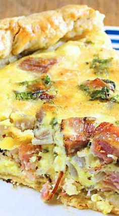 Cast Iron Quiche with Ham Sharp Cheddar Cheese _ Awesome! Savory black pepper olive oil crust stuffed with ham sharp cheddar cheese. Satisfying for even the hungriest diner! In keeping with a cast iron philosophy, I kept the seasoning straightforward! Quiches, Omelettes, Breakfast Quiche, Breakfast Dishes, Breakfast Time, Breakfast Recipes, Vegan Breakfast, Cast Iron Skillet Cooking, Iron Skillet Recipes