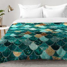 MERMAID BEDDING! Check out the best mermaid bedding and quilt sets for your beach themed bedroom. For everyone who loves mermaid decor and home themes, these mermaid duvet covers, quilts, and comforter sets are amazing.