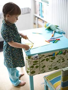 """kids canvas crafts supplies holder organized-home (Love the supply pocket """"apron"""" on the table. Good idea for school AND for the chalkboard coffee table at home.)"""
