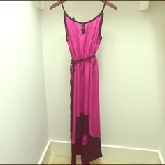 Floor Length High-Low Dress Absolutely beautiful dress. Hot pink with black trim and a black tie belt. Small key hole cut out in the front and back. Only worn once!!! Medium size could also fit small! Boutique Dresses High Low