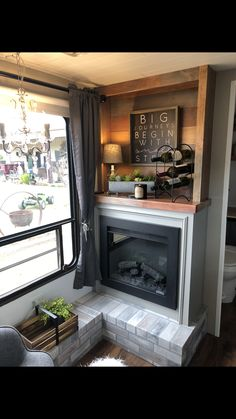 We took out the cramped booth and added a cozy sitting area and fireplace. Tiny House Living, Rv Living, Diy Camper, Camper Life, Rv Life, Travel Trailer Remodel, Travel Trailers, Rv Redo, Rv Homes
