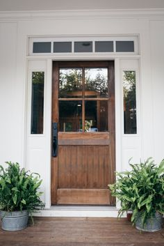 Farmhouse Friday: Our Favorite Exterior Design Choices -- The door is FIR, and the stain is dark walnut, by minwax! http://www.simpsondoor.com/find-a-door/?view=detail&baseSpecificationID=3236