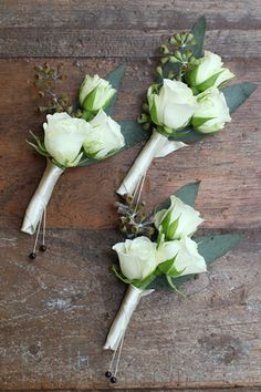 Boutonnieres with Snow Flake spray roses and seeded eucalyptus. By Cincinnati wedding florist Floral Verde LLC.