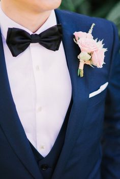 This groom has his bow tie game on point. Romantic Blush Estate Wedding - MODwedding