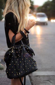 Studded handbag + exposed zipper