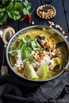 This Coconut Acorn Squash Curry is a feel good fall and winter dinner recipe that is naturally vegan + paleo + so delicious. It reheats great so make extra for lunch!